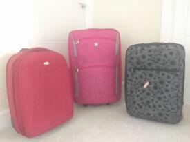 Three medium size suitcases - Free
