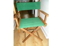 green canas and wood folding directors chair