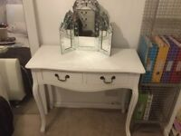 Dressing table, chair, mirror and bedside table.