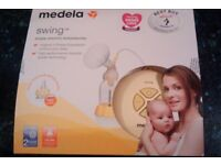 Medela Swing Electric Breast Pump with TWO Calma 150ml bottles £60