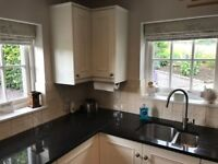 Utility/Kitchen cabinets with granite worktop and sink plus tall wall units