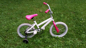 Pink and white kids bike, 16 inch wheels, excellent condition.