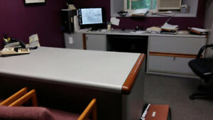 Desk, credenza, chairs and display cabinets.
