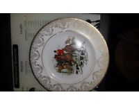 Two plates with hunting scenes on white backrounds