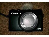 Canon G7x with 4 batteries. Best vlogging camera