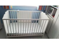 White cot and mattress for sale