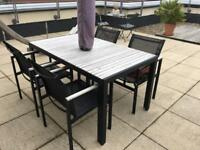 Garden tables chairs and umbrella