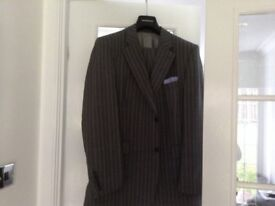 Four gents suits for sale