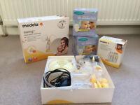 Medela Swing Electric Breast Pump, 2 Medela bottles, 120 Lasinoh nursing pads & much more included