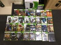 xbox 360 Slim boxed and 30+ games.