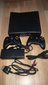 Xbox 360 2 comtrollers and games