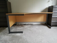 Pale wood curved office desk with metal legs