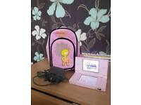 Pink Nintendo ds lite with charger, carry bag, and Hannah montana game