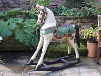 Beautiful and stylish wooden rocking horse.