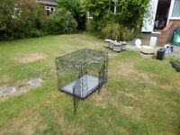 "Large dog cage. Size 24""x 34""x 27.5"" up. Lies flat to 4"" when collapsed. Very good condition"