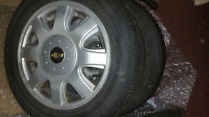set of four tires and rims for chevy aveo or spark. Were on 2005