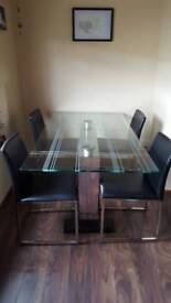 Glass dining table and 4 chairs, black and chrome