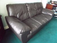 Free brown leather three seater sofa