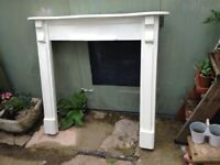 Pine painted fire surround.