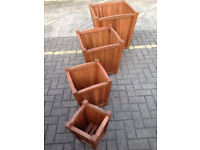Set of 4 planters - new in box