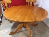SOLID Pine table and 4 SOLID Carver chairs for sale.