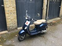 Limited Edition Vespa LXV 125. Great condition. Low Mileage