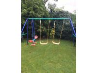 Double swing set with seesaw