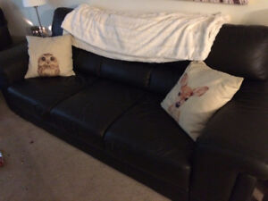 Black leather couch with love seat and ottoman