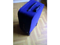 Dark blue suitcase with retracting pull handle