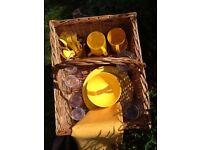Wicker picnic basket with plates, mugs, cutlery and plastic glasses for 4 people