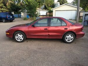 1997 Pontiac Sunfire w/ New All-Weather Tires