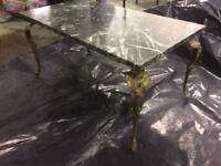 Guinea marble top table with brass legs