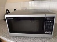 Sharp Microwave. R270SLM Compact Touch Control 20L 800W 8 Programme's Microwave Oven in Silver