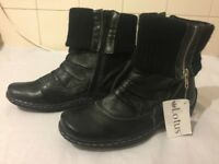 Unworn black half-boot size 4