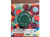 Vinyl 45 rpm records for sale, covers damaged and most labels written on