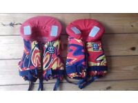 2 childrens life jackets