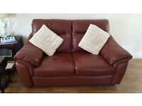Burgandy 2 seater leather sofa and footstool