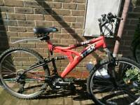 Large trax full suspension mountain bike