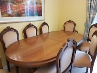 Large extending dining room table with 6 chairs and 2 carvers