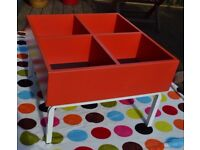 CHILDS RED WOODEN STORAGE TABLE - BOOKS - TOYS - 4 INDIVIDUAL STORAGE BAYS - GOOD STURDY METAL BASE