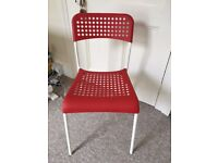 TWO IKEA ADDE CHAIR RED
