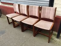 Four sturdy dining chairs