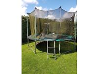 Trampoline 12ft, with net and ladder, fair condition
