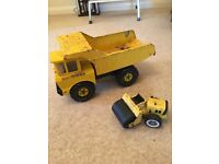 2 antique tonka trucks