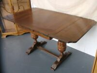 Carved antique extendable dining table