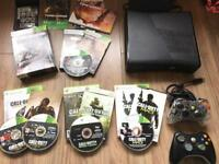Xbox 360 S console and games