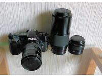 VINTAGE MINOLTA 7000 35mm CAMERA and LENSES + Kodak EK100 instant camera.