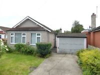 Two bed bungalow with lounge, fitted kitchen, private garden, garage and off road near town centre