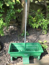 Grass seed/fertiliser spreader - used only once.
