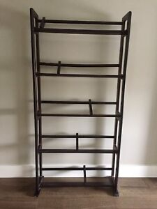 Dark wood DVD rack